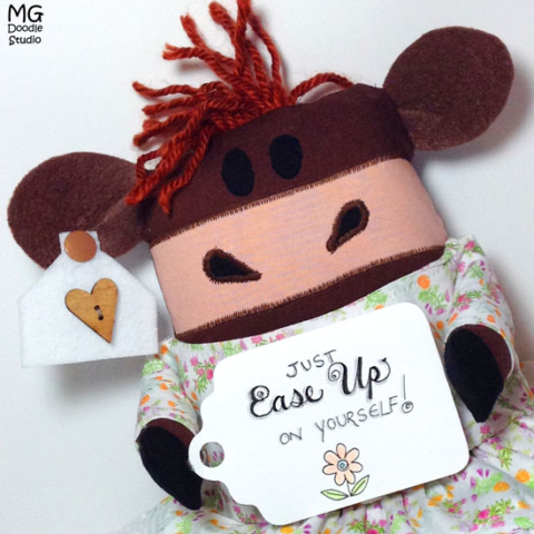 Cow softie sewn and designed by Michelle Goggins at MG Doodle Studio